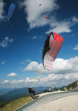 Paraglider taking-off in the Alps Stock Photo