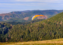 Paraglider taking off from mountain Royalty Free Stock Image