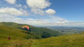 Paraglider taking off from a mountain. Start stock video footage