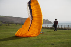 Paraglider taking of at praa sands cornish coast royalty free stock photo