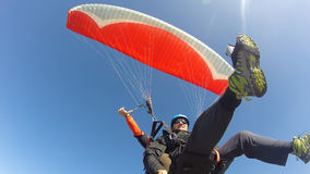 Paraglider tandem from below. Clear blue sky Stock Photo