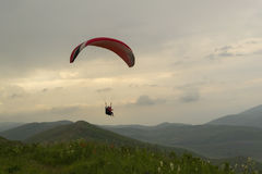 Paraglider tandem flight in mountains Royalty Free Stock Photography