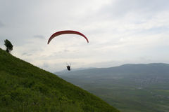 Paraglider tandem flight in mountains Royalty Free Stock Image