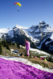 Paraglider who is preparing for flight above Engelberg Stock Photo