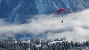 Paraglider and winter landscape Stock Images