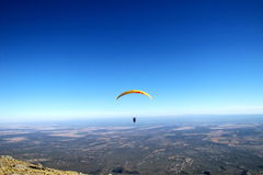 Paraglider. Yellow paraglider on blu sky Royalty Free Stock Image