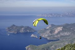 Paraglider fly over the coastline from the top of Babadag,. Paragliderfly over the coastline from the top of Babadag, Turkey, beautiful view of the coastline Stock Photography