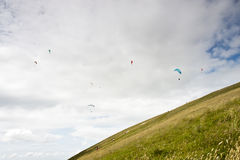 Paragliders. Paraglider in flight over a landscape Stock Images