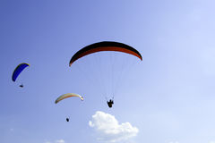 Paragliders. Some para-gliders on the blue sky royalty free stock images