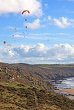 Paragliders above the coast Stock Photo