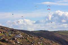 Paragliders above Freathy Royalty Free Stock Photography