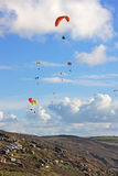Paragliders above Freathy Stock Images