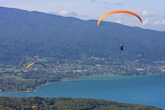 Paragliders above Lake Annecy Stock Photo