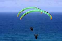 Paragliders above the sea Stock Photos
