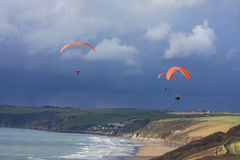 Paragliders above Whitsand Bay Stock Photography