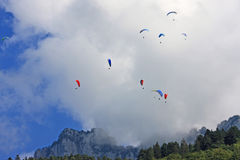 Paragliders in the Alps Stock Photo