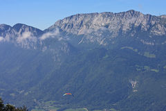 Paragliders in the Alps. Paraglider flying in the French Alps Royalty Free Stock Images