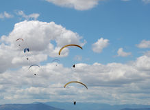 Paragliders on a background of blue clody sky. Paragliders on a background of blue clody  sky Stock Photography