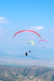 Paragliders on a background of blue sky. Paragliding in Macedonia Stock Photos