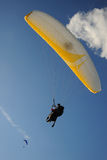 Paragliders in the blue sky Stock Image