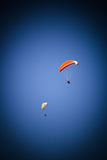 Paragliders on the blue sky Stock Photo
