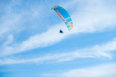 Paragliders in bright blue sky, tandem of instructor and beginner.  Stock Photography