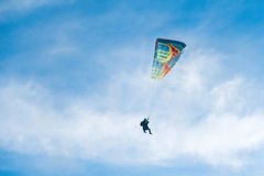 Paragliders in bright blue sky, tandem of instructor and beginner.  Stock Images