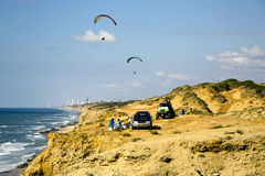 Paragliders flying above Mediterranean near Arsuf coast Stock Images