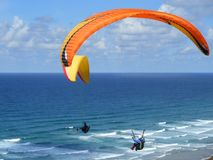 Paragliders flying Stock Image