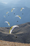 Paragliders flying against Tahtali mountain near Antalya 2014 Royalty Free Stock Images