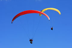 Paragliders flying Stock Photos