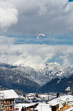 Paragliders flying over the mountain. Under partly cloudy sky, Morzine, France Royalty Free Stock Photography