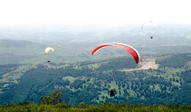 Paragliders flying in Romania Stock Photos