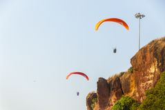 Paragliders in India. Paragliding at the coastline of Varkala in India Royalty Free Stock Photos