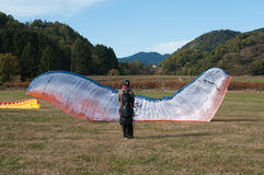 Paragliders just landed in a field Stock Images