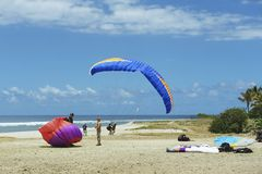 Paragliders land at the Indian ocean shore in Les Colimatons Les Hauts De Reunion, France. Stock Images