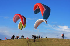 Paragliders launching Stock Photos