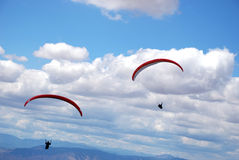 Paragliders in Macedonia. Two paragliders on the background of blue, cloudy sky Stock Photo