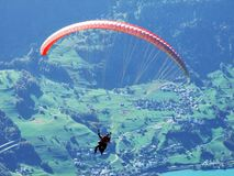 Paragliders on the mountain chain Churfirsten and above Lake Walensee stock photography