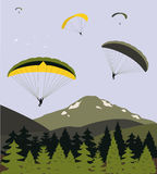 Paragliders nad górami Zdjęcia Stock