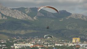 Paragliders over the city. Two paragliders over the city stock video