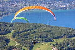 Paragliders over Lake Annecy Stock Images