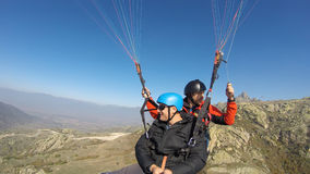 Paragliders over rocky mountain Royalty Free Stock Photography