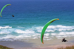 Paragliders over the sea Stock Photo