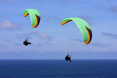 Paragliders over the sea Stock Photography