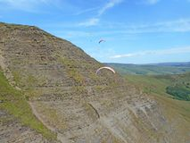 Paragliders at Mam Tor. Paragliders in the Peak District at Mam Tor stock image