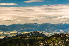 3 paragliders. Photo was taken in Low Tatras national park  from Chopok peak looking towards Demanovska valley, Slovkia stock images