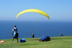 Paragliders Prepare for Liftoff. August 28, 2006 - La Jolla, California, USA: A young paraglider waits his turn as another paraglider prepares to take off at the Royalty Free Stock Photo