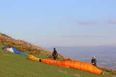 Paragliders preparing their wings Royalty Free Stock Photos