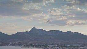 Paragliders ridge soaring, ridge lift stock video